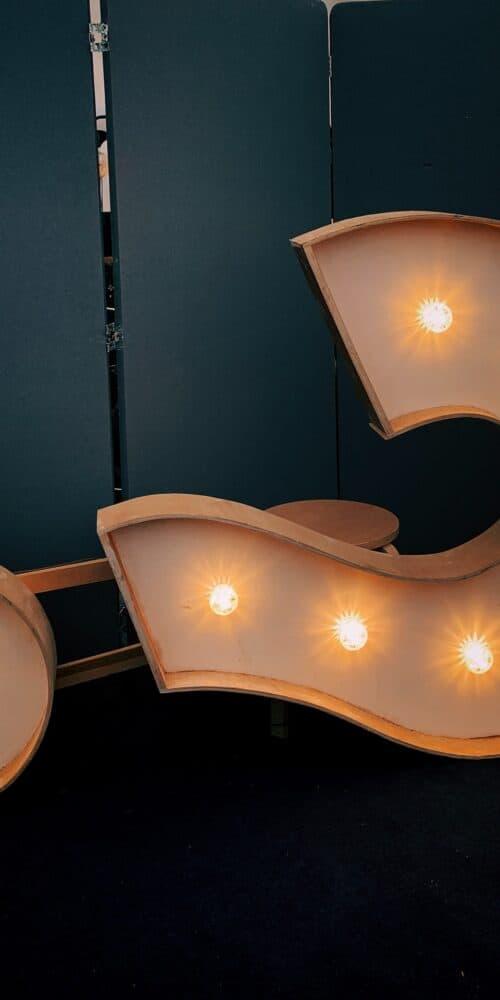 Question Sign on side, in lights by Jon Tyson_Unsplash