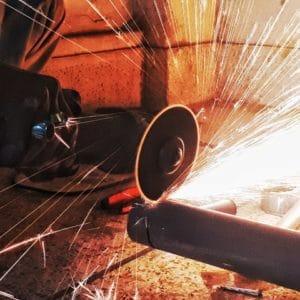 Abrasive Wheel cutting metal sparks flying